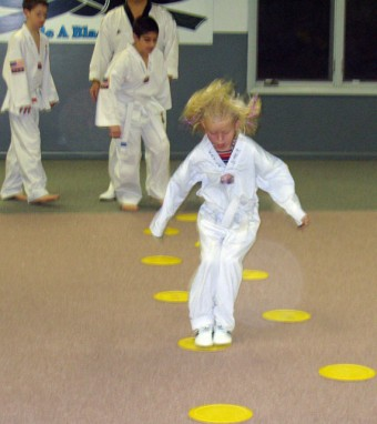 Girl Jumping at Tae Kwon do
