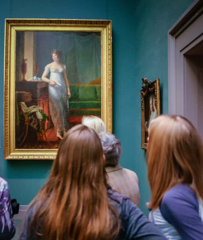 Patrons admire painting at the Met in NYC