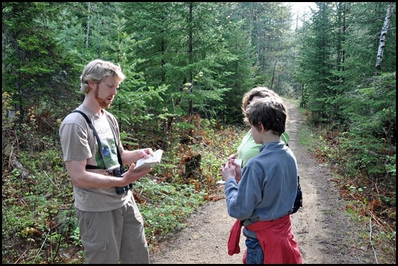 Alan Belford leads a bird watching expedition in the Adirondacks.