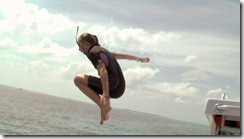 girl-jumps-into-ocean-Bahamas