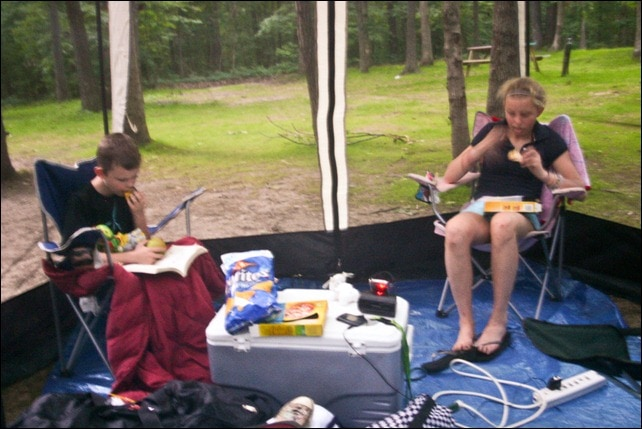 Kids reading in a screened in ten at Injun Joe Campground - Hannibal MO