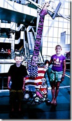 Two kids posing with the guitar - Rock and Roll Hall of Fame - Cleveland OH