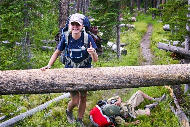 Big sister laughing over brother's fall - Yellowstone backpacking trip.