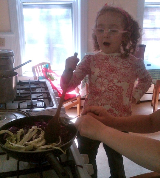 kids healthy cooking cabbage stirring