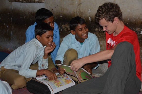 Reading to village school children - Jaipur, India