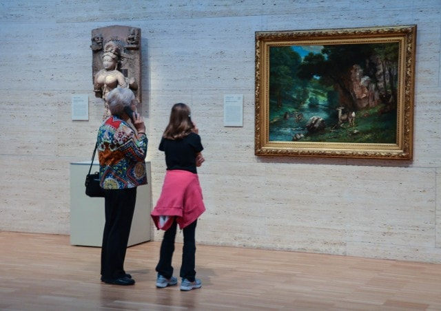 Kimbell Museum - Grandmother and girl listen to the audio guide.