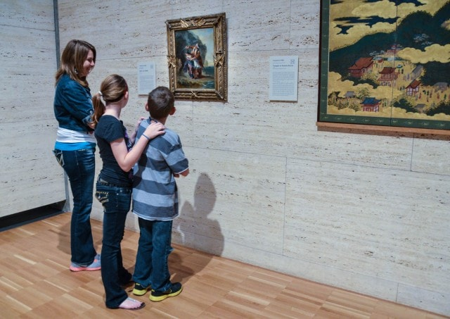 Kimbell Museum - Family viewing Delacroix's Selim and Zuleika - a tragedy about a harem girl and a pirate inspired by Lord Byron's romantic poetry.