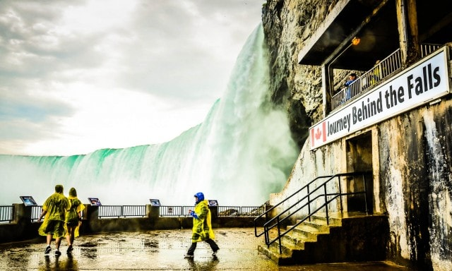 Spectators in yellow rain ponchos view Horseshoe Falls at Journey Behind the Falls - Niagara Falls, ON