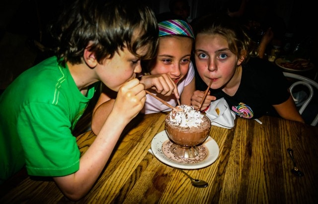 Three kids sharing a Frozen Hot Chocolate at Serendipity 3 in New York City.