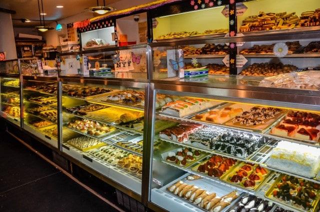 Pastry display - with canoli - at La Bella Ferrara.   New York City