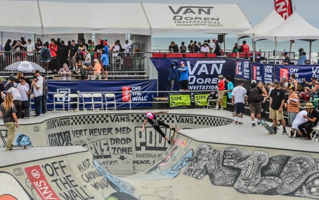 Girl skateboarding on concrete bowl at Van Doren Invitational in Huntington Beach, CA