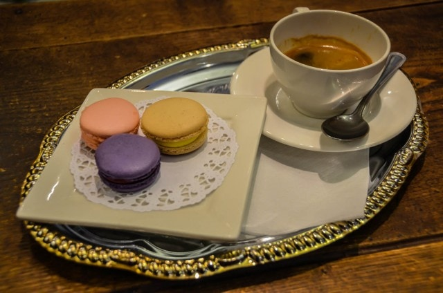 Macarons and espresso on a silver tray served at La Maison du Macaron in New York City.