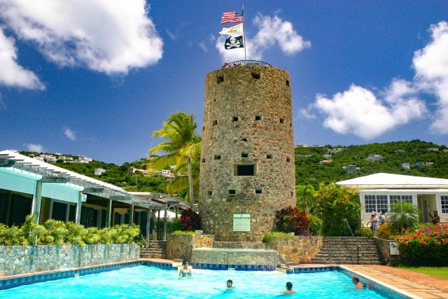 People swimming in pool in front of Blackbeards Castle in St. Thomas, US Virgin Islands.